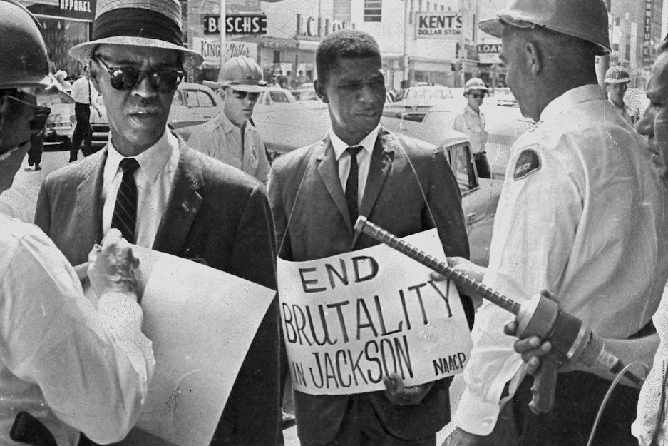 1963 NAACP leaders Roy Wilkins and Medgar Evers picketing